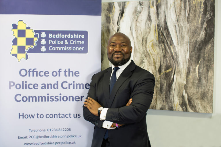 """Festus Akinbusoye has been elected as Bedfordshire's new Police and Crime Commissioner (PCC). Festus was the Conservative candidate for the May 2021 election and brings a wealth of experience including serving as a Special Constable with Bedfordshire Police. The Commissioner said """"I pride myself on maintaining valuable relationships with Councillors on local issues, Members of Parliament on national matters and advising government ministers on issues ranging from drugs policies to better supporting victims of domestic abuse. I also place high value on speaking to the community directly and listening to their concerns"""" Festus also served as a link governor for the Offender Learning and Skills Services team which delivered training and education in prisons. His passion for working with youths doesn't stop there, he is a former Parish Councillor and he worked with the Council to get funding for a Youth Club following a rise in anti-social behaviour.  The Office of the Police and Crime Commissioner is now working with Festus to deliver a Police and Crime Plan based on the manifesto he was elected upon. Invest to bring back community-based policing for both our urban and rural communities Tackle drug dealing, antisocial behaviour and the causes of these crimes Support law-abiding citizens' rights to a peaceful life in our county and put victims' needs first Lead a multi-agency approach to early intervention and tackling re-offending Lead an open and transparent policing area.  Chief Executive for the Office of the Police and Crime Commissioner said """" My office has welcomed Festus on his first day as he takes the oath of a Commissioner. We have been working on his commitments made during the election and will now begin the process of engaging our partners, Bedfordshire Police and most importantly the people of Bedfordshire on the Police and Crime Plan that will be launched this summer.""""  Chief Constable Garry Forsyth said: """"I'm really pleased to welcome X into the role an"""