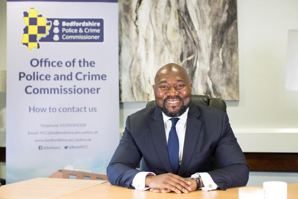 Festus Akinbusoye sitting at his desk