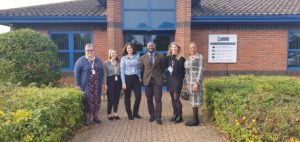 The PCC for Bedfordshire and the FDAC Team standing outside the OPCC